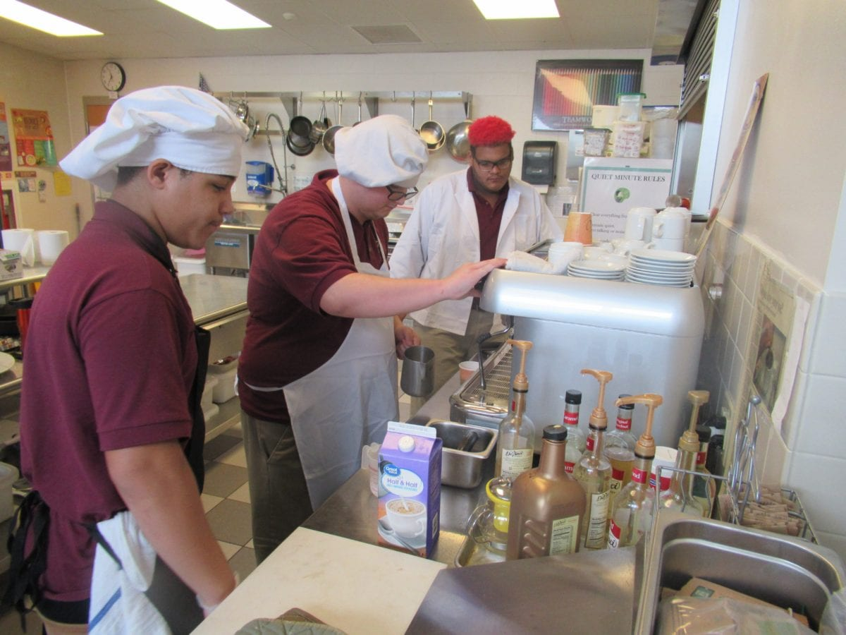 Students learning barista skills in culinary arts