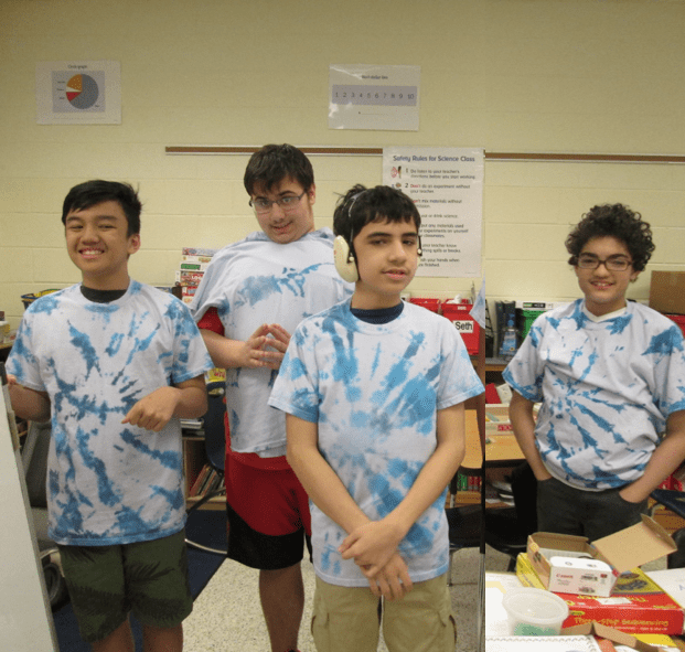 Students showing off their t-shirt making skills