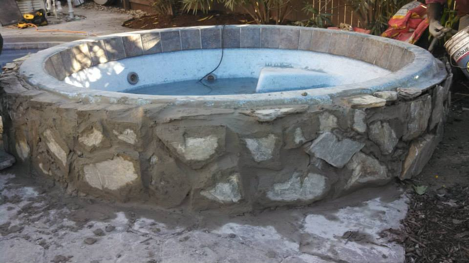 Stone masonry hot tub (during)
