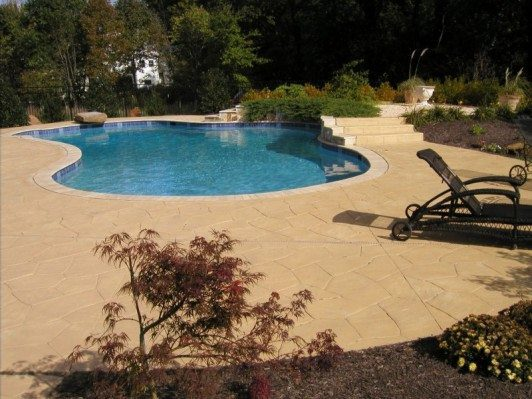 Stamped pool deck with trim & stairs