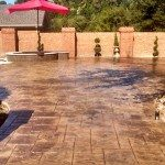 Stamped pool deck with hot tub masonry