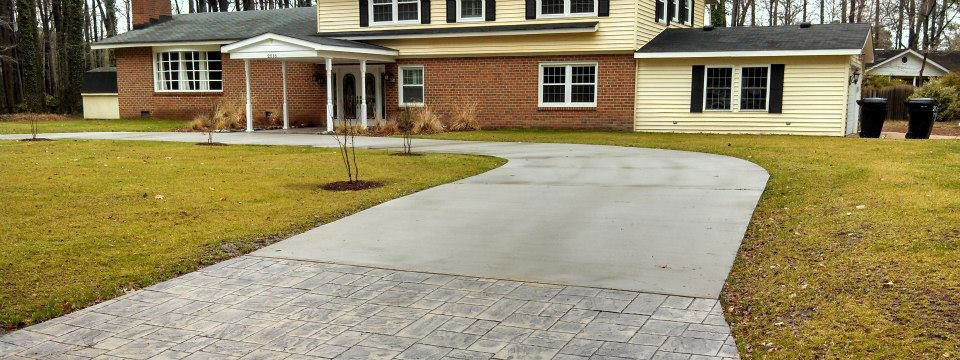 Circular broom finish driveway with stamped apron